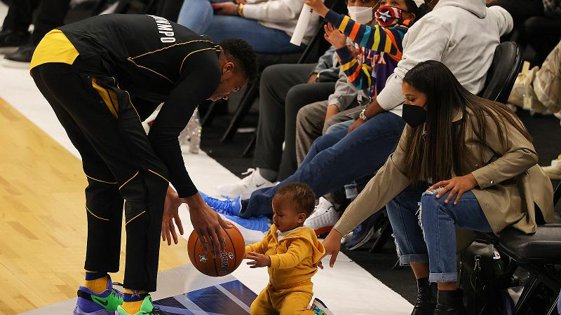 giannis with kids on the court